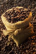 Coffe beans in gunnysack, close-up - stock photo
