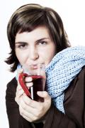Stock Photo of Young woman drinking health tea