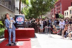 Dave koz.dave koz honored with rhe 2,389th star on the hollywood walk of fame Stock Photos