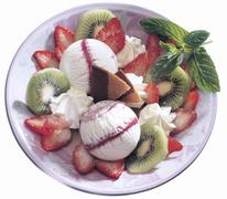Ice cream Yogurt, wildberries with fruits - stock photo