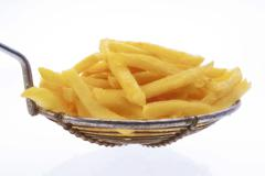 Dipper with chips, cut-out, white background Stock Photos