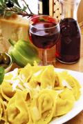 Agnolotti with fresh parmesan - stock photo