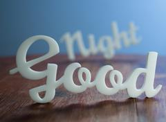Good Night on Wooden Table. Stock Photos