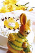Easter bunny in front of Easter cake Stock Photos