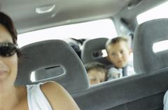 Family in a car - stock photo