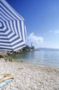 Croatia, Dubrovnik, woman lying on towel at beach, low section - stock photo
