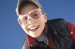 Boy smiling, low angle view - stock photo