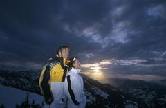 Stock Photo of Couple standing on mountain