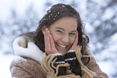 Woman in snow with hands on face Stock Photos