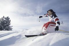 Stock Photo of Woman skiing in snow