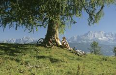 Austria, Salzburger Land, biking couple having rest - stock photo