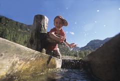 Boy splashing water Stock Photos