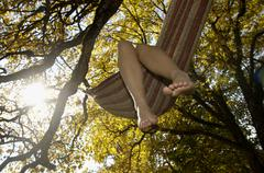 Feet dangling from hammock Stock Photos