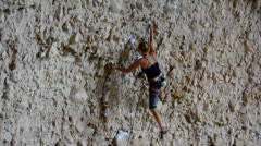 Female Rock Climber on Steep Conglomerate 3 Stock Footage