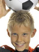 Boy (10-11) with soccer ball, close-up Stock Photos