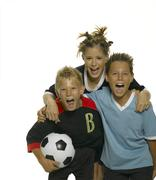 Teenage girl with boys with football shouting, close-up - stock photo