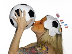 Woman from Netherlands kissing soccer ball Stock Photos