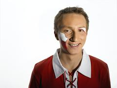 Male soccer fan from Poland, close-up - stock photo