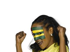 Stock Photo of Woman with Togo flag painted on face, close-up, portrait