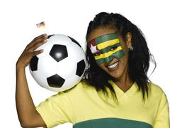 Stock Photo of Female soccer fan from Togo, portrait