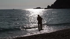Father plays with the small daughter of the sea, Adriatic Sea, Montenegro Stock Footage