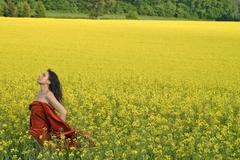 Woman in rapeseed field Stock Photos