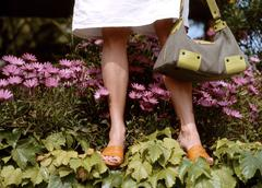 Woman holding handbag, low section Stock Photos