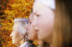 Grandmother, mother and daughter, side view - stock photo