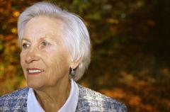 Stock Photo of Senior woman looking away, smiling, close up