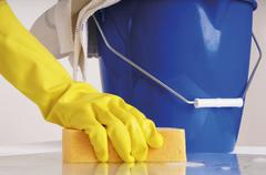 Person cleaning with sponge - stock photo