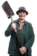 Old man with shovel Stock Photos