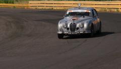 Full HD shot of vintage car Jaguar MkII. Peking to Paris international rally - stock footage