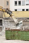 Wrecking crane and debris container - stock photo