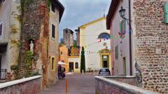 Establishing shot. Valeggio sul Mincio, village on river, Italy. Stock Footage