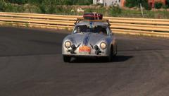 Silver Porsche 356A followed by Mercedes Benz 300 SE ヨ retro cars competition Stock Footage