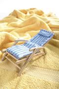 Deck chair on a towel - stock photo