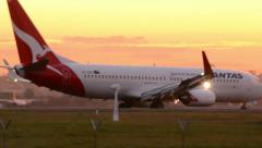 Qantas Jet taxing at Airport at Sunset 160GYAP 0013 NTSC Stock Footage