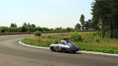 Porsche 356A and Ford Mustang Convertible move far away Stock Footage