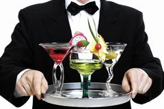Stock Photo of barkeeper holding tray with cocktails