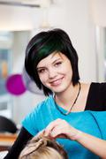 smiling young hairdresser - stock photo