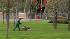 Worker mow lawn cutter Stock Footage