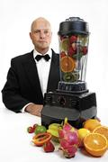 barkeeper and mixer with fruit - stock photo