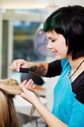 young woman working at the hairdresser - stock photo