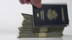 Taking passport and stacks of cash Stock Footage