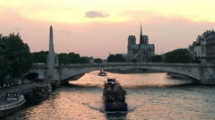 PARIS - Notre Dame Cathedral and Old Boat on Seine River - stock footage