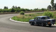 Australian retro auto Holden EH makes sharp turn on driveway Stock Footage