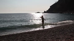 young woman floating in the sea, Adriatic Sea, Montenegro - stock footage