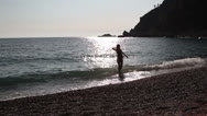 Stock Video Footage of young woman floating in the sea, Adriatic Sea, Montenegro