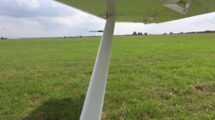 Stock Video Footage of aircraft wing in motion on airfield
