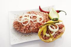 Roll with minced meat and onions, elevated view - stock photo